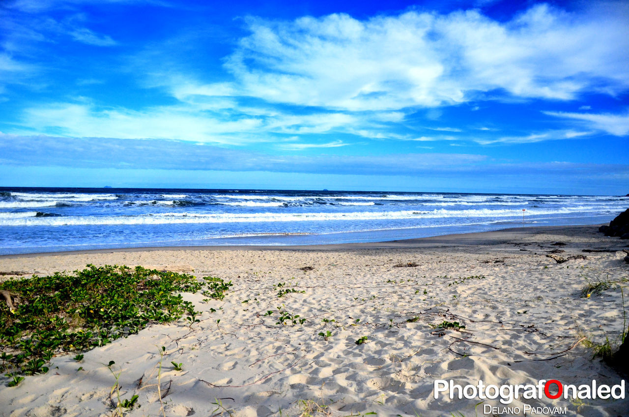 sea, beach, horizon over water, sky, water, scenics, cloud - sky, nature, beauty in nature, shore, sand, tranquility, tranquil scene, blue, day, wave, no people, outdoors, travel destinations, vacations