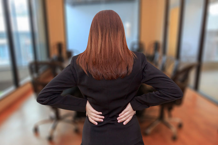 Rear view of businesswoman standing in office