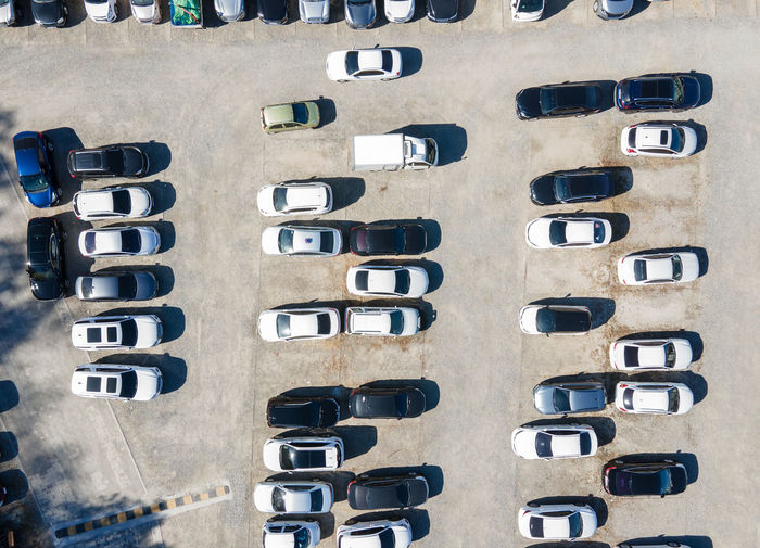 Outdoor parking with a cars top view, a aerial footage.