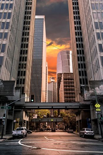 City Skyscraper Architecture Building Exterior Built Structure Sunset Outdoors Car No People Travel Destinations Office Building Exterior Modern Sky Downtown District Red Light Day