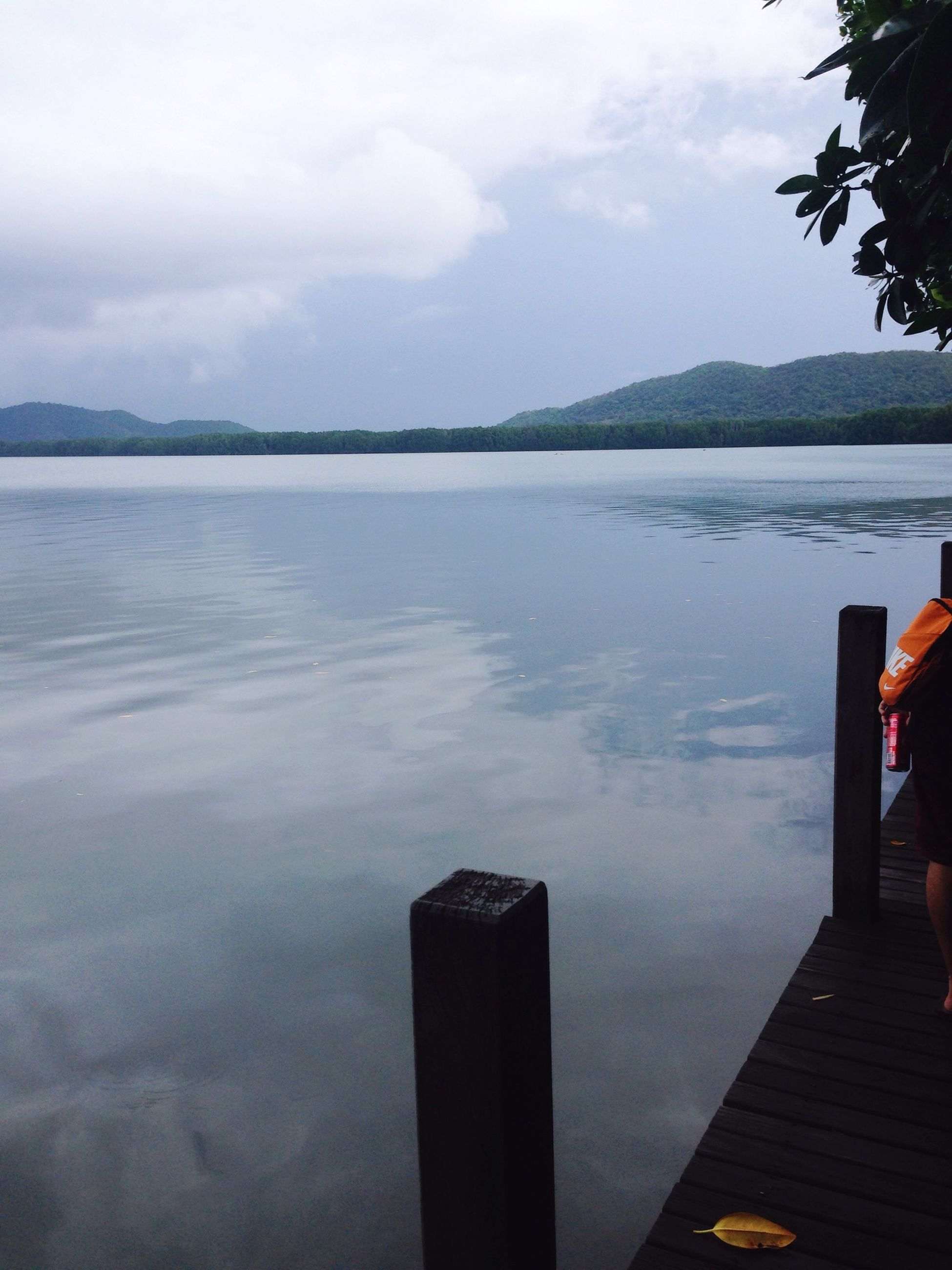 water, sky, lake, tranquil scene, cloud - sky, mountain, tranquility, scenics, beauty in nature, pier, nature, cloud, reflection, cloudy, idyllic, outdoors, day, mountain range, calm, sea