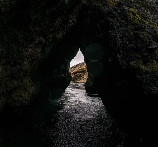 Keyhole. Rock Formation Tunnel Nature Natural Arch Water River Beauty In Nature Scenics Outdoors Iceland Memories Iceland_collection Iceland Iceland Trip Kvernufoss Keyhole Peephole Traveling Skogar Travel Photography Travel Destinations Roadtrip Nature Beauty In Nature Travel Arch