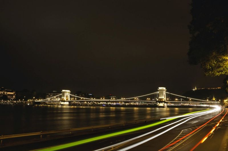 Light trails on suspension bridge at night