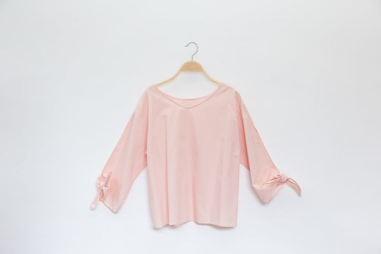 Hanger Pink Blouse Blouses Casual Clothing Close-up Clothing Coat Hook Coathanger Copy Space Cut Out Dress Fashion Hanging Indoors  Nightie No People Pink Color Single Object Still Life Studio Shot Wall - Building Feature White Background White Color Womenswear