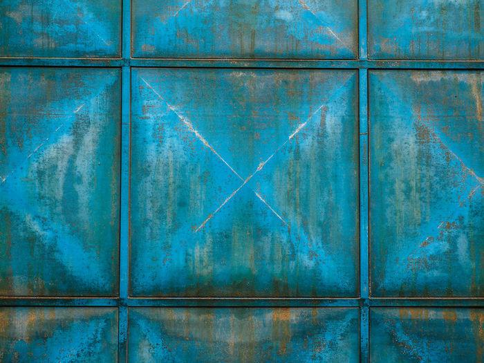 Full frame shot of weathered blue metal