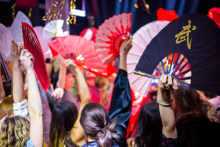 Arts Culture And Entertainment Real People Women Event Celebration Adult Galactic Fan Thai Group Of People Crowd Large Group Of People Focus On Foreground Day Rear View Outdoors Arms Raised Clothing Togetherness Human Arm Festival Human Limb