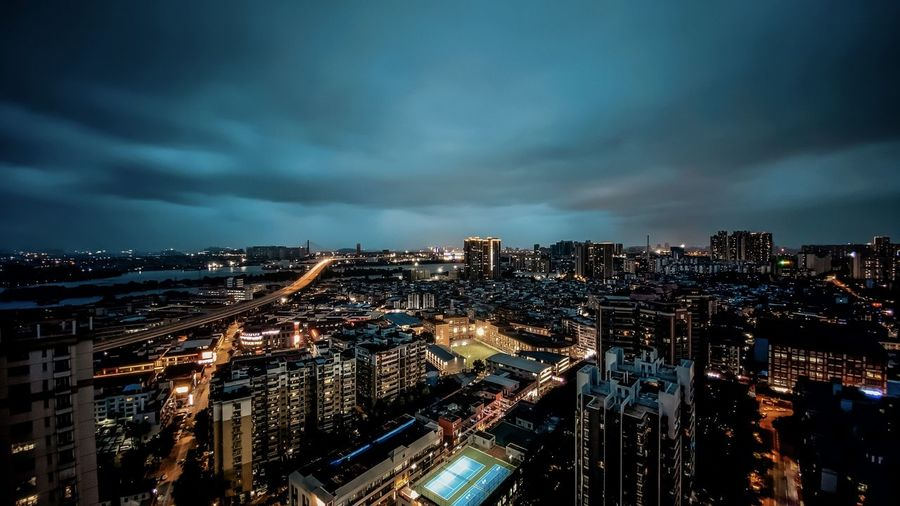 High angle view of illuminated city buildings at night in guangzhou