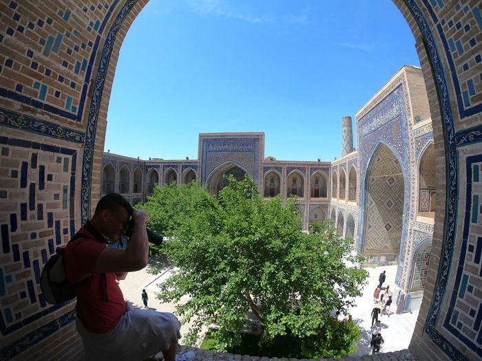 Fisheye view of Ulugbek madrasah inner courtyard. Samarkand. Uzbekistan Travel Destinations Outdoors The Past Tourism Travel Young Adult History One Person Building Exterior Lifestyles Arch Built Structure Real People Architecture Samarkand Samarqand Registan Uzbekistan Ulugbek Madrasah Madrasa Silk Road Tourism Destination Central Asia UNESCO World Heritage Site Unesco Ex Soviet Countries Asian  Majolica Place Of Worship Islamic Architecture Islamic Art Islamic