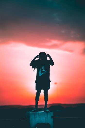 Sunset Silhouette Orange Color Real People Full Length Standing One Person Outdoors Sky Lifestyles Nature Men Beauty In Nature Day People