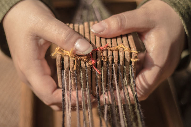 17th century weaving machine Hands Close-up Day Food And Drink Freshness Holding Human Body Part Human Hand Indoors  One Person People Real People Twine, Cord, Yarn, Thread, Strand, String Weaving Comb Weaving Loom Weaving Machine