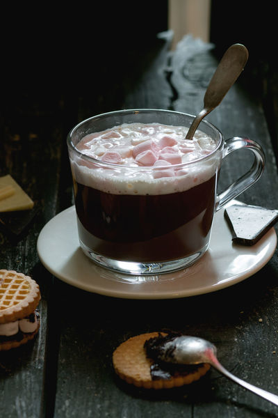 Glass cup of Hot chocolate with marshmallows, cookies stuffed by marshmallows, and chopping chocolate over old wooden table. Dark rustic style. Natural day light Beverage Chocolate Coffee Dark Dessert Marshmallow Pink Coockies Dark Background Drink Foam Food And Drink Foodphotography Glass Hot Chocolate Hot Drink Indoors  Mug Sweet Sweet Food Table Wooden