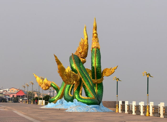 Giant Naga Statues Giant Twin Green And Gold Naga Statues By Mekong River Naga Tourist Attraction  City Landmark Clear Sky Day Nature No People Outdoors Sculpture Sky Statue Thai Tourism Tourism