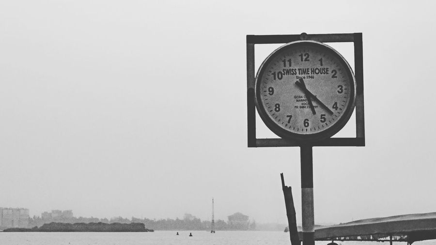 Close-up of clock against clear sky