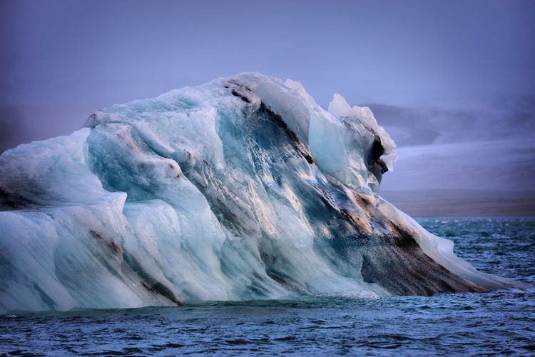 Scenic View Of Iceberg Against Sky