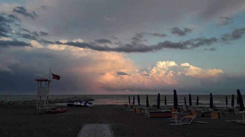 Redflag in the Stormy Weather on the Italian Beach