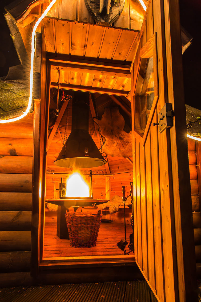 illuminated, lighting equipment, no people, indoors, fire, burning, glowing, fire - natural phenomenon, flame, heat - temperature, architecture, wood - material, light, built structure, electric lamp, nature, night, electric light, oil lamp, electricity, ceiling
