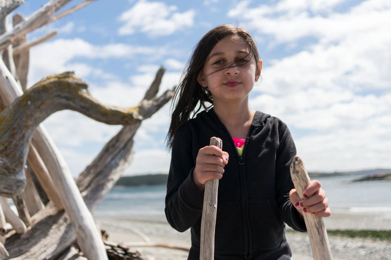 exploring the beach Childhood Worn Wood Children Travel Travel Destinations San Juan Islands Washington State Hiking Exploration Looking At Camera Girl One Woman Only One Person Front View Happiness Outdoors Smiling Day Fun Carefree Enjoyment Beach Adventures In The City The Portraitist - 2018 EyeEm Awards Be Brave