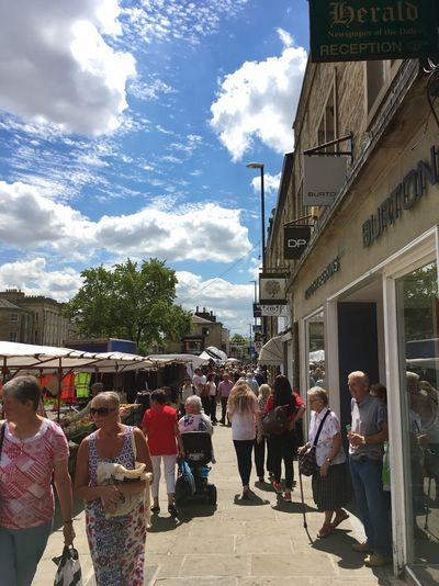Market day in Skipton, Yorkshire Stall Market United Kingdom England Skipton Yorkshire Group Of People Real People Building Exterior Crowd Large Group Of People Architecture Built Structure Cloud - Sky Adult Lifestyles Day Street Building