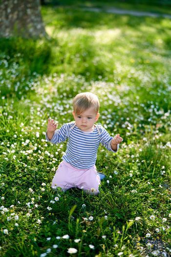 Cute baby girl on field