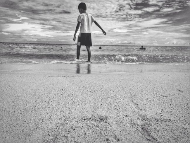 breathe once in a while Seascape For The Love Of Sea Breathing Fresh Air Relaxing Moments Boy Walking By The Beach Chasing Waves Enjoying Life No Worries Free Spirit Oceanlife My Escape  My Refuge Solitude EyeEm Best Shots - Black + White Black & White Eyeem Philippines Eyeem Bohol Mobile Photography