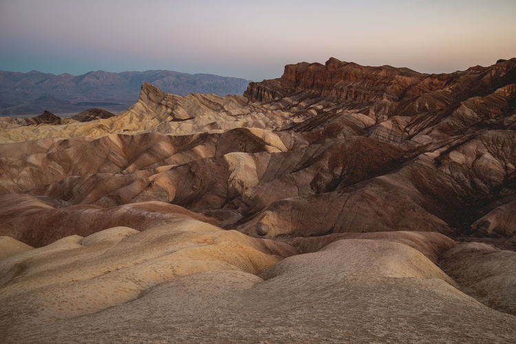 Before sunrise shot of the eroded landscape at Zabriskie Point, Death Valley, California, USA. Zabriskie Point Death Valley Death Valley National Park Amargosa Range Eroded Landscape Red Cathedral Manly Beacon Eroded Landscape Sunrise High Resolution Sediments Iconic Landmark Texture Soft Colors  Travel Travel Destinations Geology Rock Formation Formation Mountain Range Desert No People Rock Layers And Textures