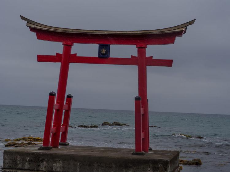 A Shrine Cloudy Sky Coast Ocean Rock Sacred Wave