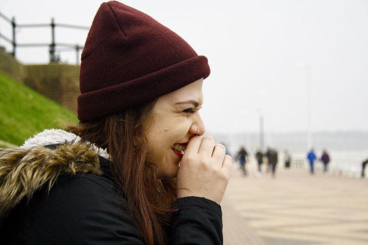 Close-up of smiling young woman at beach
