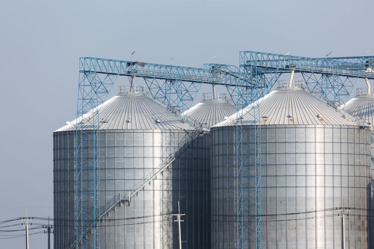 Industry Sky Factory Nature Storage Tank Metal Silo No People Building Exterior Architecture Built Structure Day Fuel And Power Generation Agriculture Storage Compartment Outdoors Clear Sky Food And Drink Industry Technology Copy Space Steel Alloy