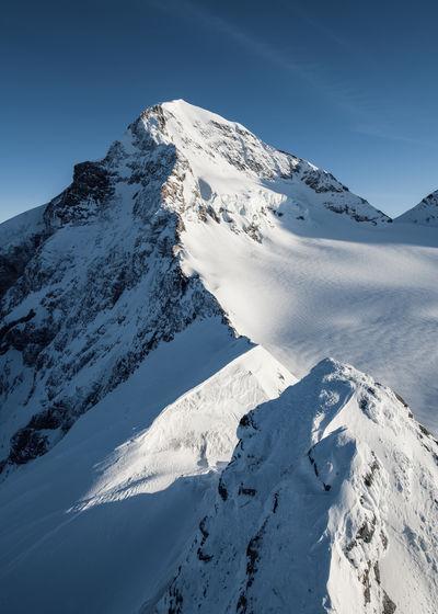 Mönch Swiss Alps Extreme Weather Extreme Terrain Cold Temperature Snow Winter Mountain Mountain Range Mountain Peak White Color Snowcapped Mountain Alps Bernese Oberland