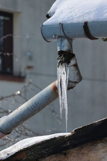 Close-up of icicle on sewage pipe