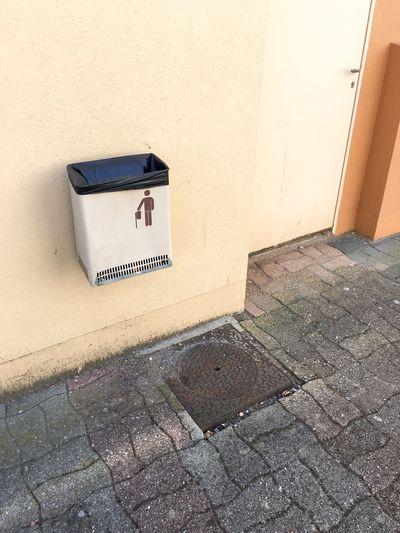 High angle view of garbage bin on wall
