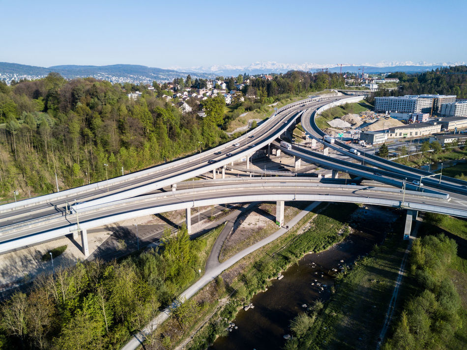 Architecture Built Structure City Connection Curve Day Elevated Road EyeEmNewHere High Angle View Highway Land Vehicle Mode Of Transport Motion Multiple Lane Highway No People Outdoors Overpass Road Road Intersection Sky Speed Traffic Transportation Tree Viaduct