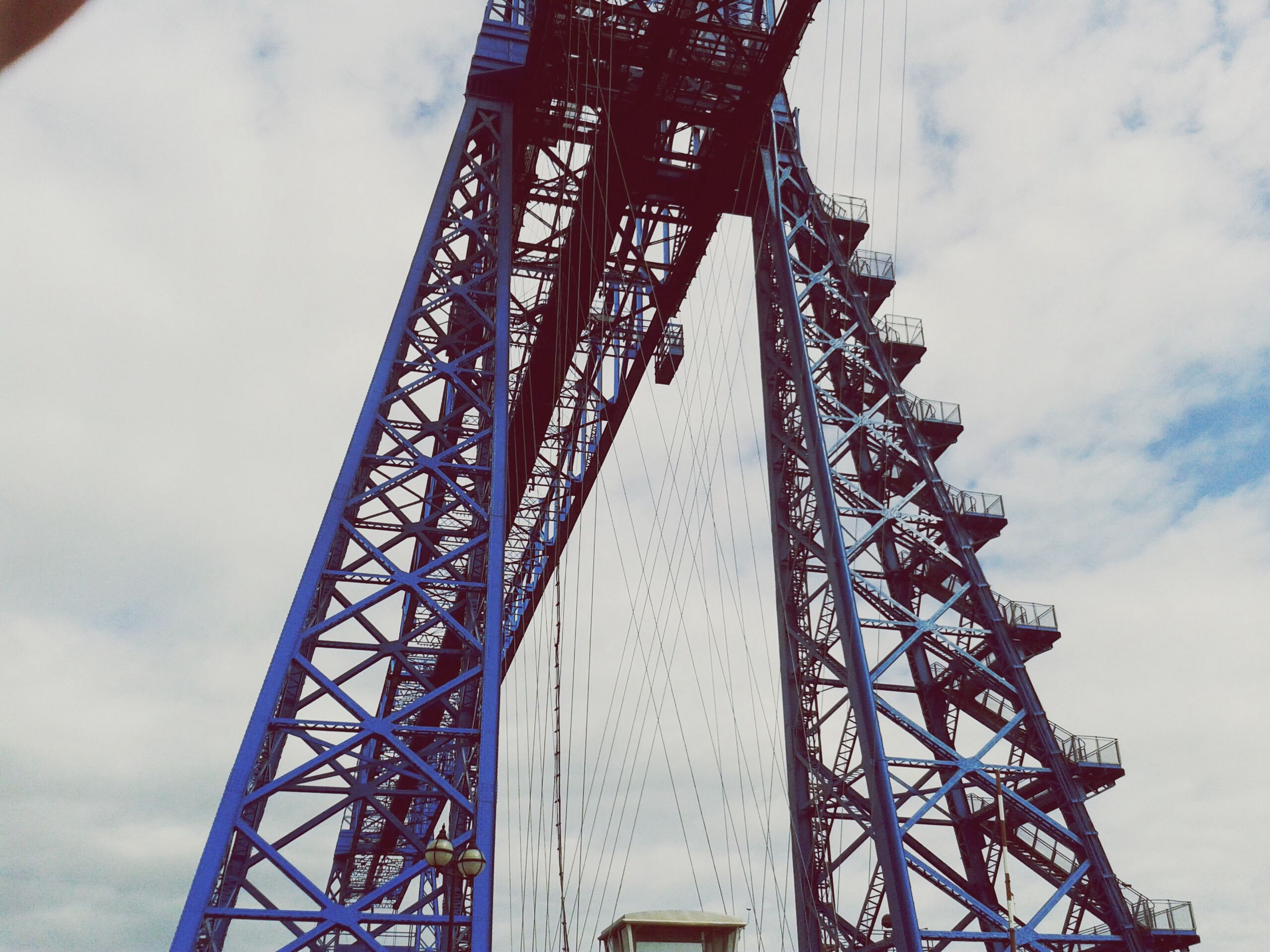 low angle view, sky, metal, day, outdoors, no people, arts culture and entertainment, built structure, amusement park, architecture, cloud - sky, big wheel