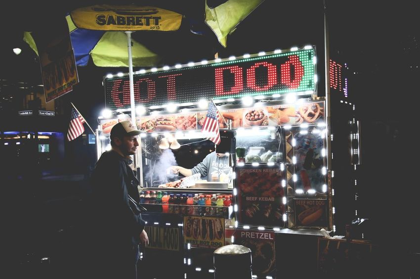EyeEm Best Shots New York City Streetphotography HotDog Street Food Worldwide Night Retail  For Sale One Person Illuminated Real People Market Neon Food People