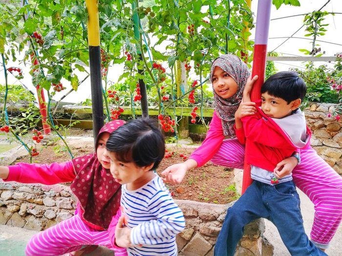Siblings playing in park