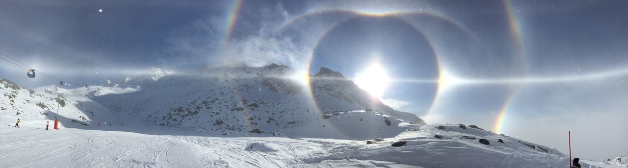 No filters! Parahelic Circle and Sun Dogs in Val Thorens, French Alpes Snow Cold Temperature Winter Season  Weather Tranquil Scene Scenics Beauty In Nature Mountain Sunbeam Tranquility Nature Majestic Sunlight Lens Flare Snowcapped Mountain White Color Idyllic Vacations Ethereal