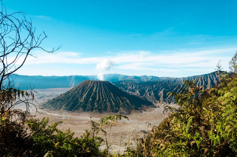 Mount Bromo EyeEm Selects Travelphotography Valcano Bromo Tengger Semeru National Park Sky Mountain Beauty In Nature Plant Scenics - Nature Tree Tranquil Scene Landscape Cloud - Sky Non-urban Scene Nature Land Environment Tranquility Volcano No People Smoke - Physical Structure Idyllic Travel Destinations Day