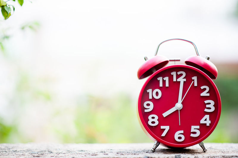 Accuracy Alarm Clock Clock Clock Face Clock Hand Close-up Communication Copy Space Day Deadline Focus On Foreground Hour Hand Minute Hand No People Number Outdoors Red Time Urgency