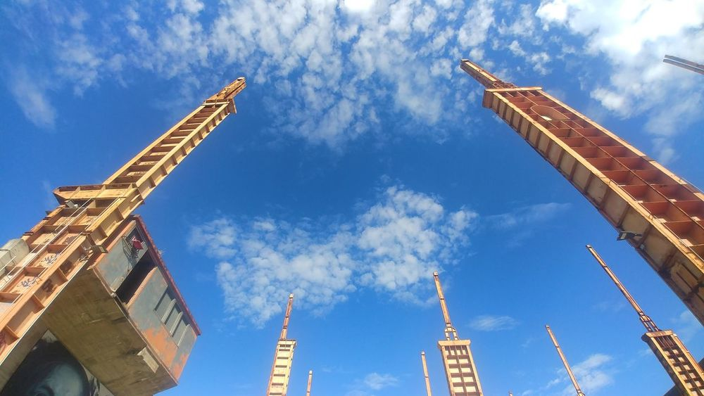 EyeEm Selects Cloud - Sky Sky Business Finance And Industry Low Angle View Architecture Day Crane - Construction Machinery Blue Travel Destinations Outdoors Built Structure Building Exterior No People City