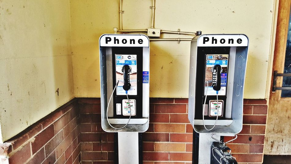 Communication Telephone Connection Pay Phone Old-fashioned Telephone Receiver Technology Text Day Convenience Telephone Booth Outdoors No People Close-up