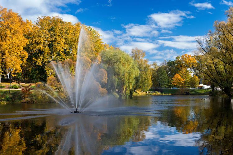 Valmiera. Latvia. City autumn landscape with a pond and fountain. Autumn Autumn colors Baltic Baltic Countries Fountain Latvia Valmiera Baltic States Beauty In Nature Cloud - Sky Day Flowing Water Foliage Lake Motion Nature No People Outdoors Reflection River Sky Tranquility Tree Water Waterfront