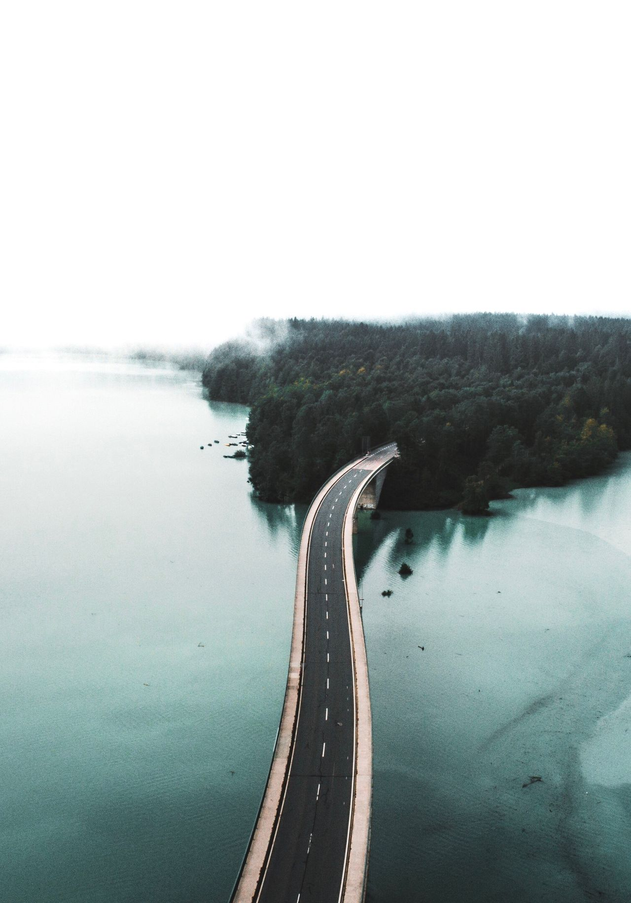 High angle view of road over sea against clear sky