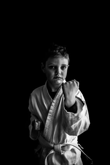 Looking At Camera Portrait Studio Shot Black Background One Person Front View Waist Up Boy Karate Martial Arts