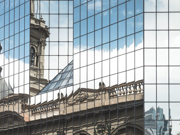 Santiago Glasses City Glasses Reflection Sky And Clouds Architecture Building Exterior Built Structure Cityscapes Contrast Day Glass Glass - Material Hispanic Low Angle View Modern And Classic Architecture Modern And Old No People Outdoors Reflctions Sky Skyscraper South America Street Urban