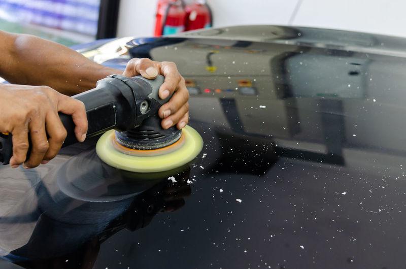 Cropped hand polishing car