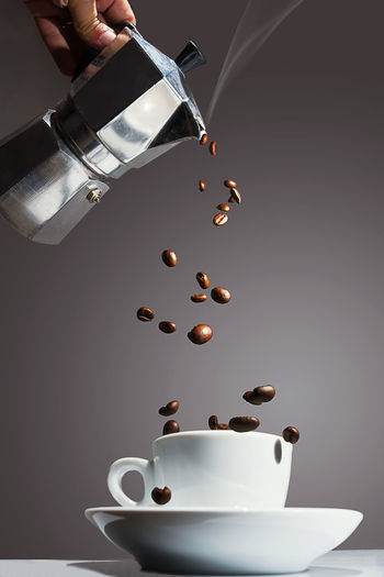 Coffee pot pouring roasted coffee beans into the cup Beans Coffee Coffee Time Moka Moka Pot Steam Berry Coffee Coffee - Drink Coffee Cup Coffee Pot Concept Conceptual Photography  Cup Cup Of Coffee Drink Grain Human Body Part Human Hand Mokapot