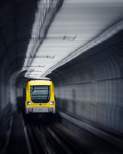 Train passing through tunnel