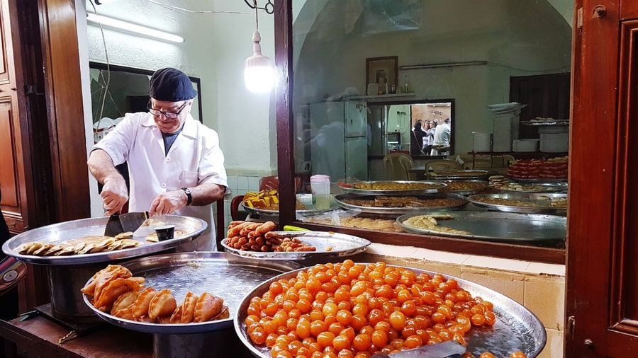 Lebanese sweets . Sidon Lebanon Lebanese Sweets Small Business Heroes Chef's Whites Men Preparation  Working Food And Drink Chopping Cutting Chef