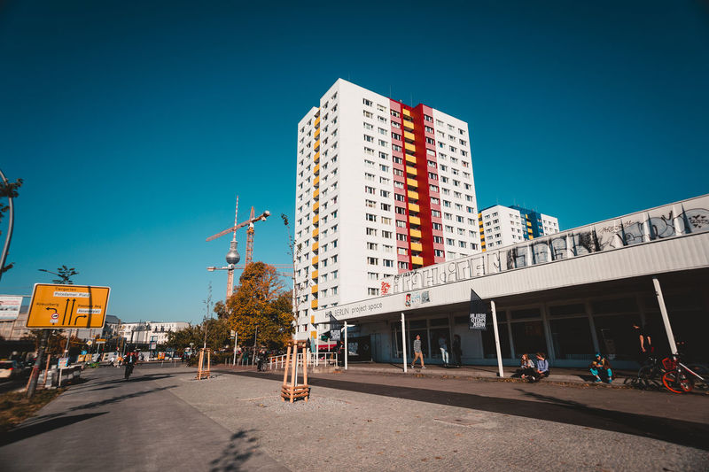 Berlin Photo Week 2018 Berlin Photo Week BPW18 EyeEem Architecture Building Exterior Sky Built Structure City Clear Sky Nature Blue Building Incidental People Sunlight Office Building Exterior Day Transportation Street Copy Space Outdoors Modern Low Angle View Road Skyscraper