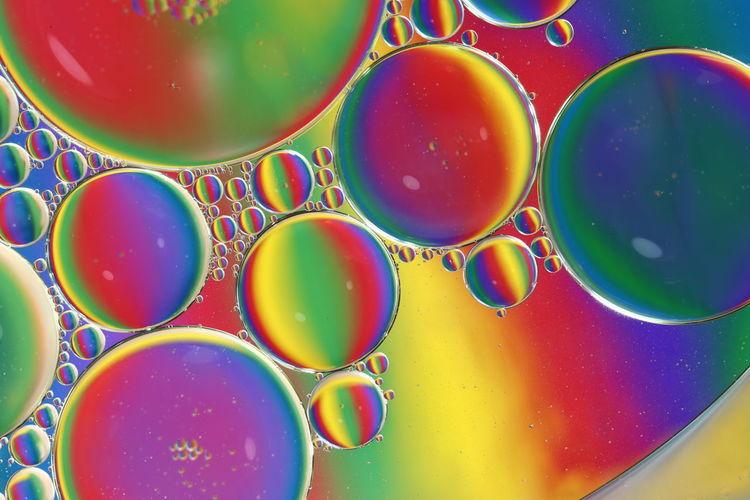 Full frame shot of multi colored bubbles